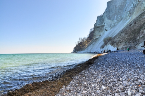The beautiful beach besides the white cliff, clean waters and beautiful weather